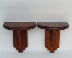 A Pair of mahogany ? wooden clock brackets of supported