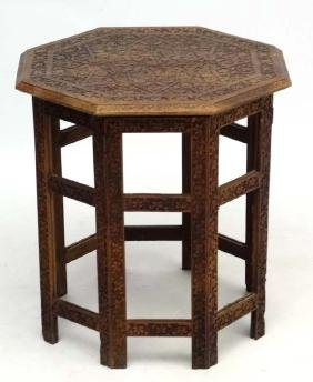 A circa 1900 Indian octagonal carved wood 2 part table