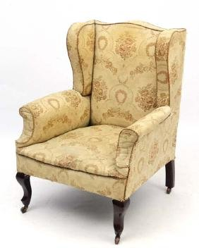 An early - mid 20thC upholstered wingback armchair 39