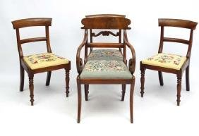 A set of 4 Regency period mahogany and Rosewood dining