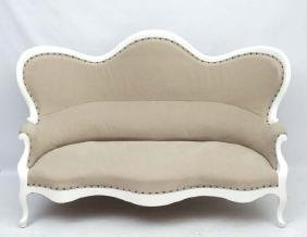 A 19thC Continental shaped settee with white painted