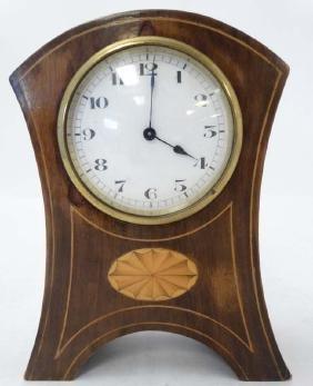 Mahogany Inlaid and shaped mantle clock  : a Swiss made