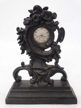 19thC Cast Iron Rococo pocket watch stand and gold