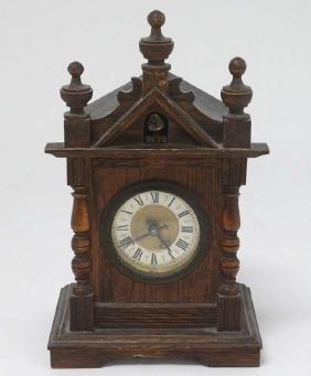 Oak cased Cuckoo mantle Clock : a German made 2 3/4''