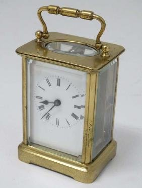 5 Glass Carriage Clock : a brass cased 5 bevelled glass