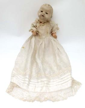 Toy: A German Bisque Childs doll, having blue glass