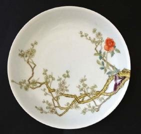 A Chinese cherry blossom bowl, decorated in polychrome