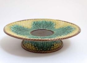A Majolica pineapple tazza decorated in yellow and