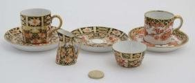An Imari pattern Royal Crown Derby c1919 cup and c1910
