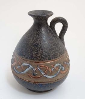 A Spanish Mejias Polonio Pottery pitcher, decorated