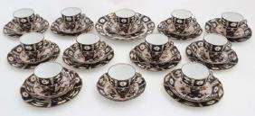 A collection of Crown Derby Imari pattern cups and