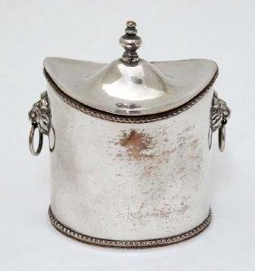 A silver plate tea caddy of ovoid form with lions mask