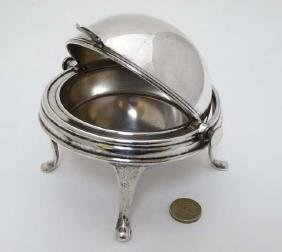A silver plated breakfast serving dish of circular form
