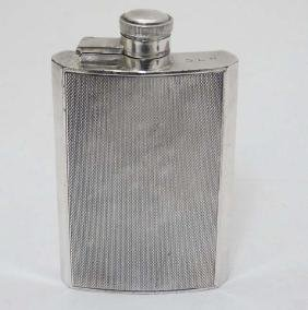 A silver plate hip flask of shaped form with engine