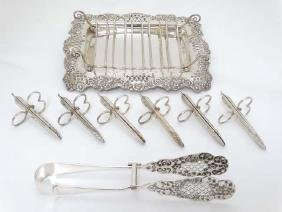 A silver plate asparagus serving dish with silver