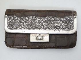 A crocodile skin purse of expanding form with silver