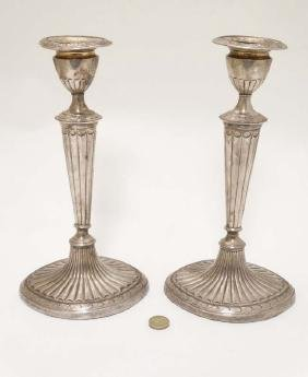 A pair of silver plate candlesticks with fluted