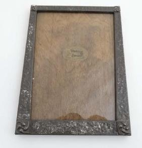 An early 20thC planished pewter photograph frame with