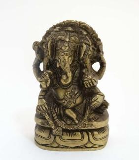A cast bronze figure of an Indian deity ( Gnesha )