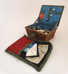 An early 20thC sewing basket with wicker base and