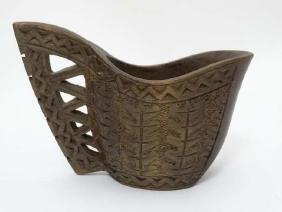 A Scandinavian chip carved wooden jug. Approx 3 3/4''
