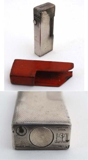 Dunhill : A silver plated lighter with red leather