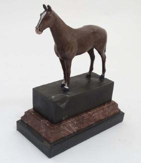 After Andre, A late 20thC cold painted bronze trophy