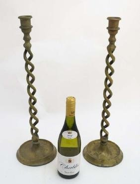 A pair of early 20thC cast brass double open twist