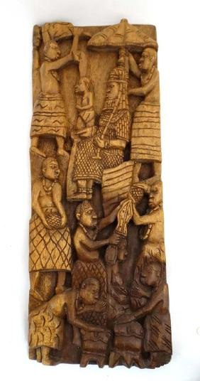 An ethnographic native tribal carved hardwood relief
