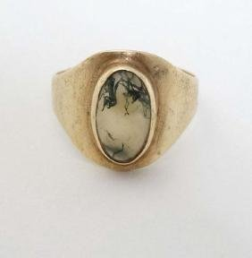 A 9ct gold ring set with moss agate cabochon