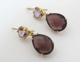 Yellow metal large drop earrings set with amethysts and