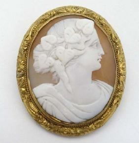 An early 20thC Cameo brooch within a gilt metal