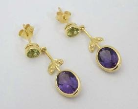 A pair of silver gilt drop earrings set with amethysts