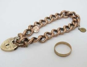 A 9ct gold ring together with a gold plated bracelet