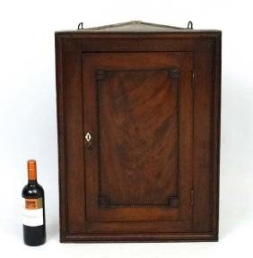 A Georgian And Later Corner Cupboard With Oak Carved