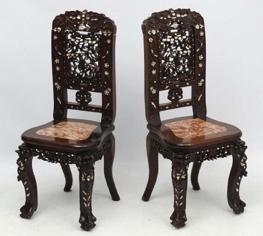 A pair of Chinese hardwood chairs with rouge marble