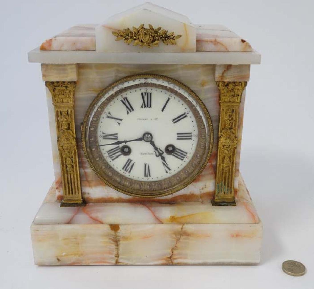 Tiffany Mantle Clock : an onyx cased and gilded applied