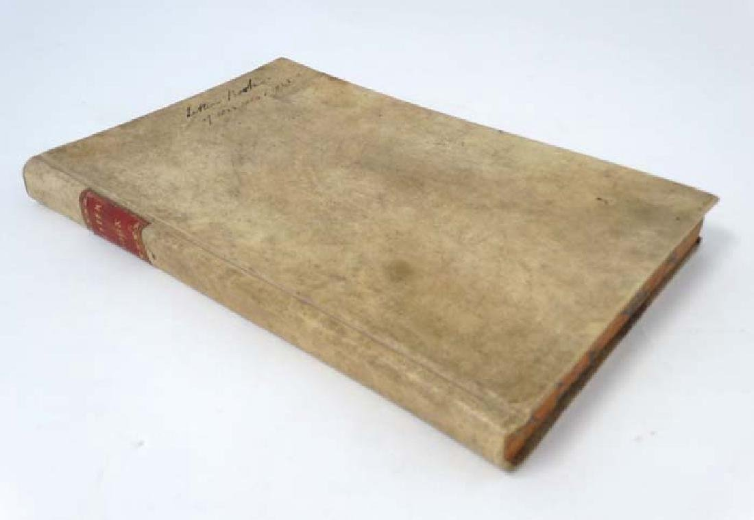 A c1920s vellum bound record / letter book, used as a