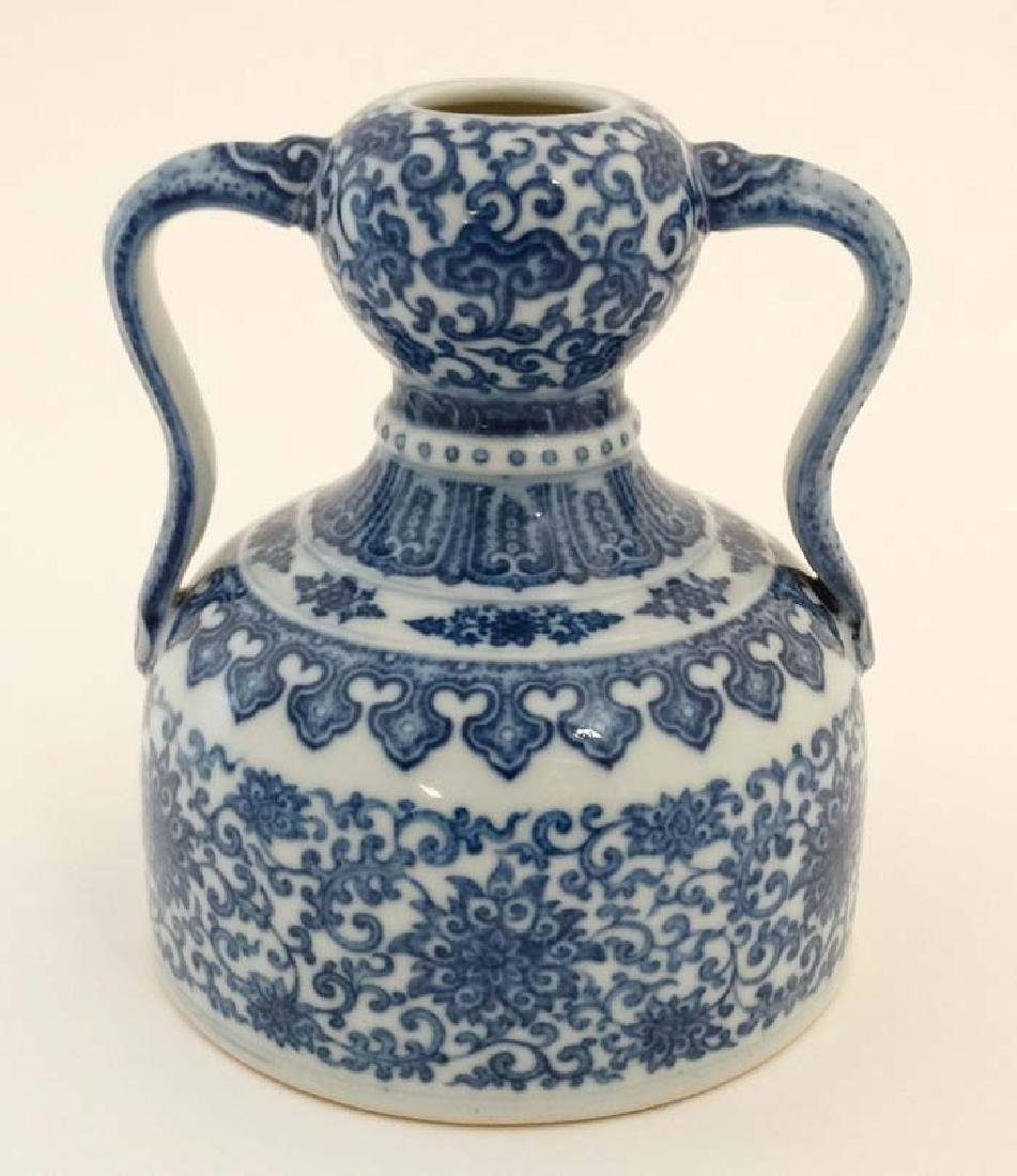 A Chinese blue and white, twin handled double gourd