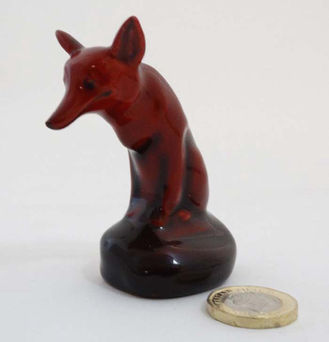 A small Royal Doulton Flambe figure of a seated fox, HN
