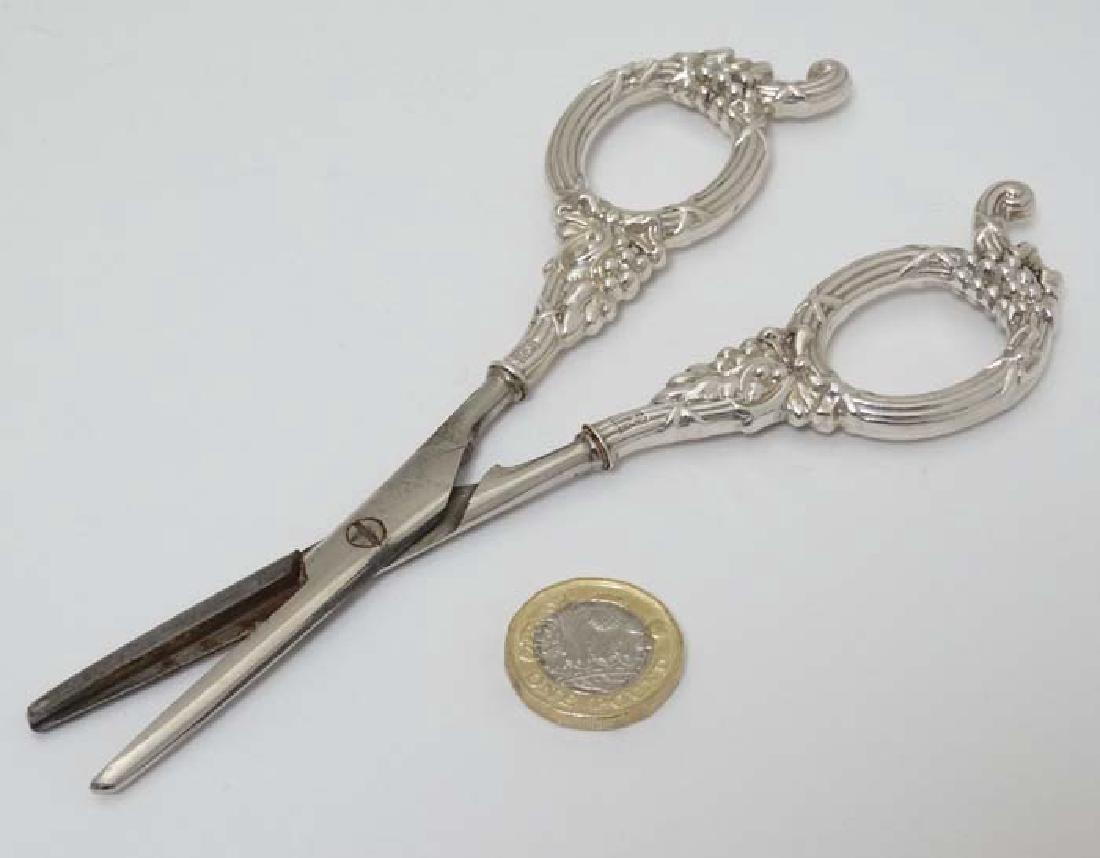 Silver handled grape scissors with cast loop handles