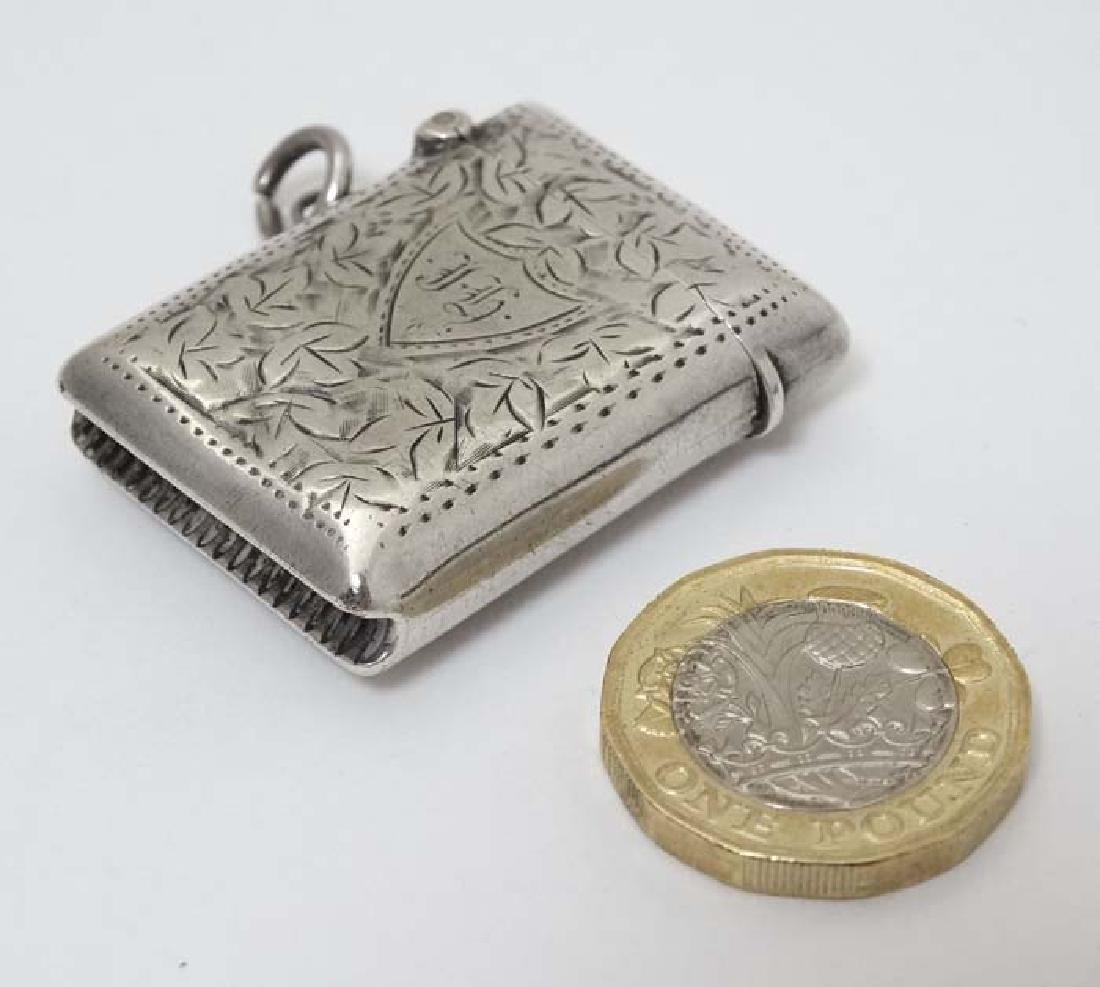 A small silver vesta case with engraved decoration
