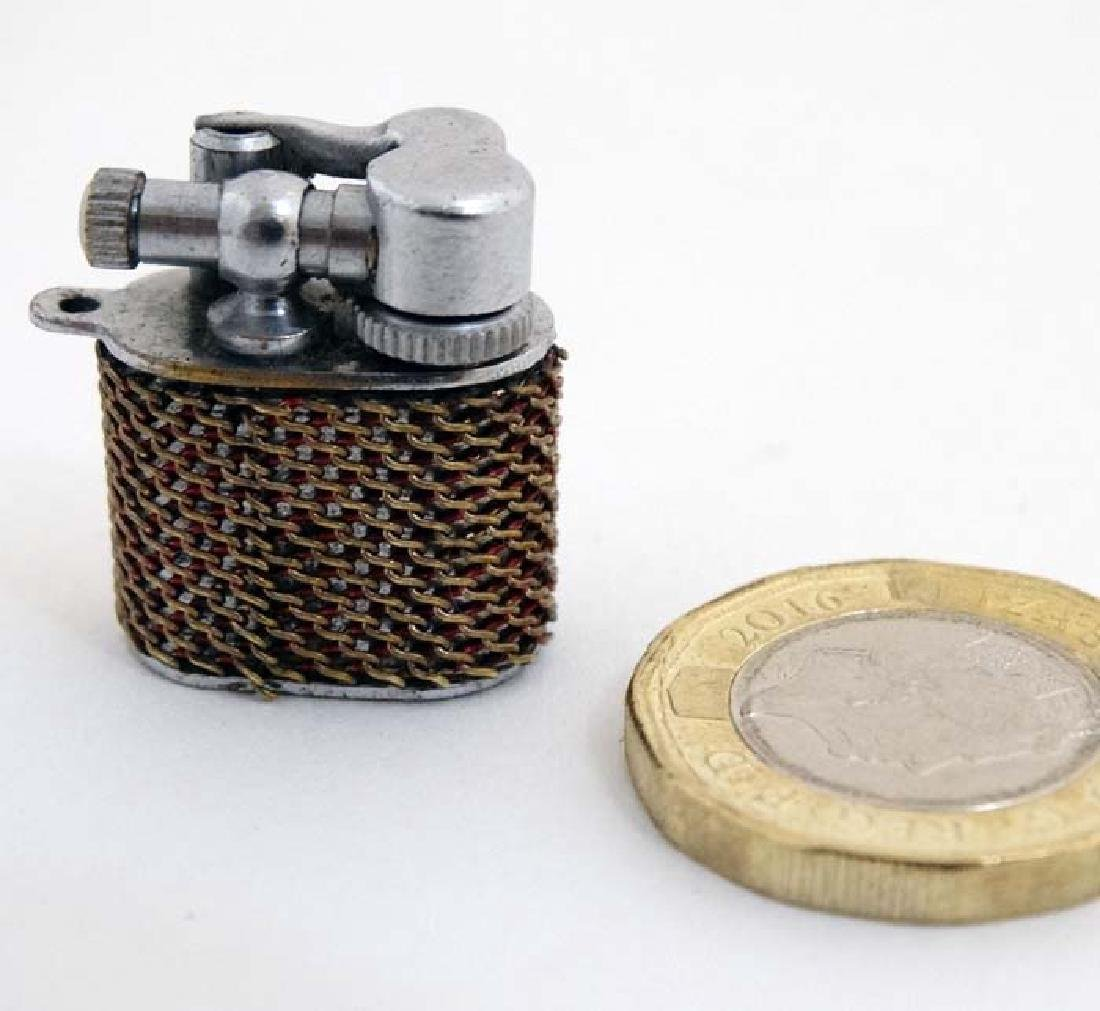 An unusual novelty miniature Lighter , stamped ' Pygmy