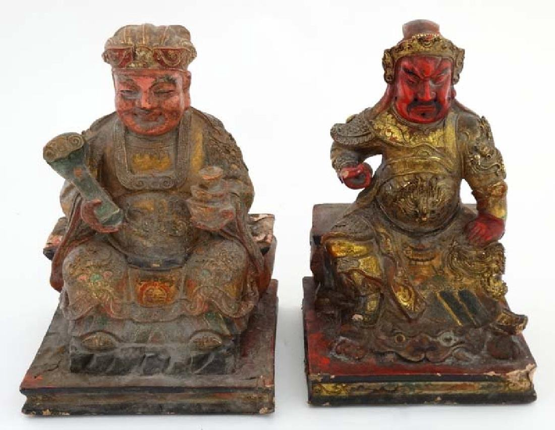 Two Chinese Immortal figures seated on squared bases,