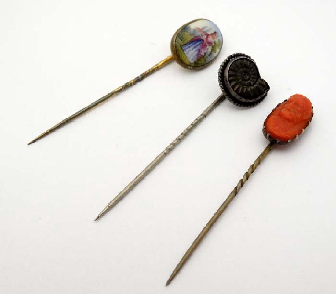 3 various stick pins, a white metal example set with