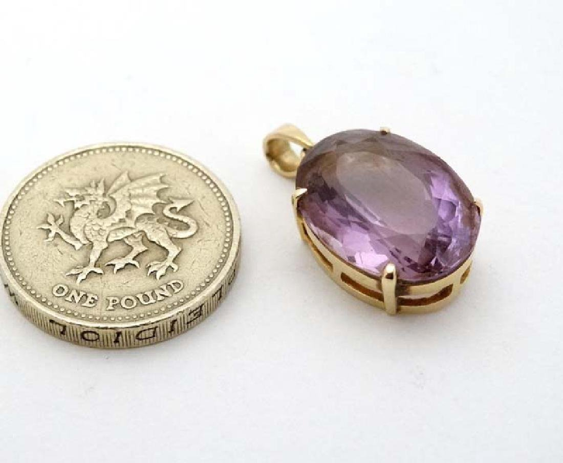 A 14ct gold pendant set with large facet cut amethyst
