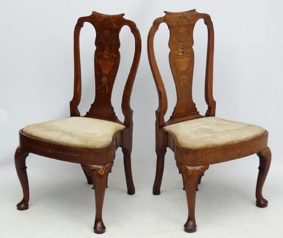 A pair of Queen Anne walnut inlaid dining chairs with