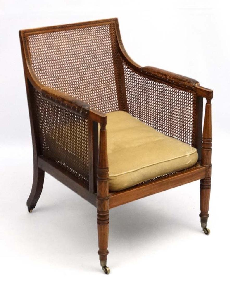 A c.1800 Regency library bergere armchair with leather