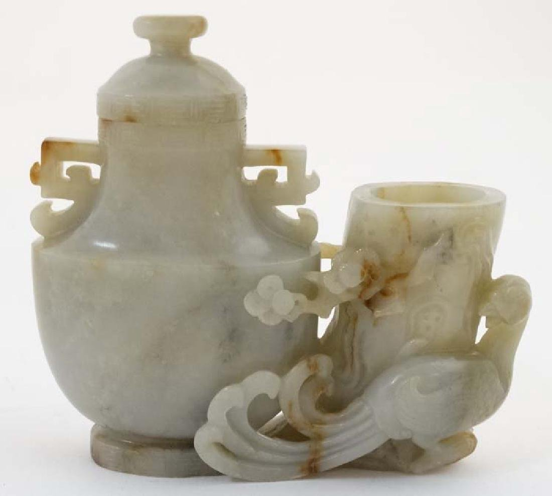 A Chinese jade pot and cover formed as a fire bird