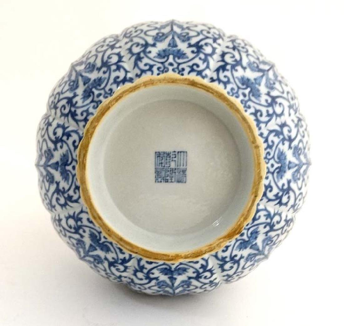 A Chinese Blue and white flared rim bottle vase of - 4